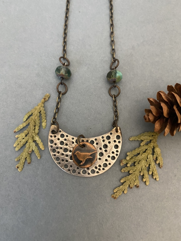 Little Bird Necklace made of copper and aluminum.